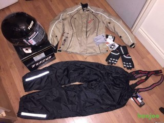 Motorcycle gear new with tags, fully armoured , full faced helmet, gloves&water proof over trousers