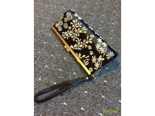 Black handbag with flower detail