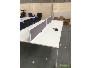 Pod of four desks with partitions