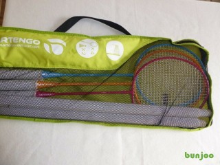 Badminton. Set – brand new. Four racquets, net, poles etc.
