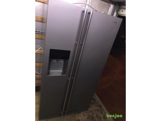 Silver Samsung American fridge freezer with drink dispenser and ice