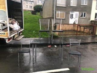 Black wood dining room table and 4 chairs£85