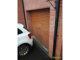 Wood effect rolling garage door 257cm wide. Only 6 years old, minor scrapes but otherwise as new.