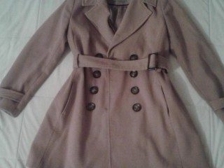 Coat from Dorothy Perkins. Size 10. Beige colour. Two large pockets. Large brown buttons & a belt.