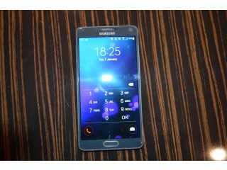 Samsung galaxy note with tough Otterbox case, spare battery etc