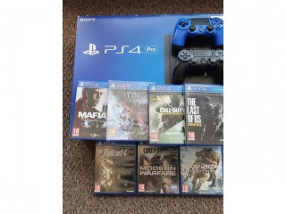 PS4 pro 1tb with 2 controllers and 7 games