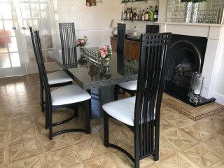 Black Granite dining room table 1700mm x 900mm & 6 black & white leather chairs