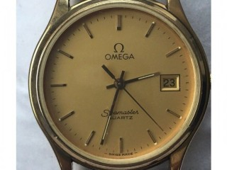 Omega Seamaster gold-plated mans wristwatch.
