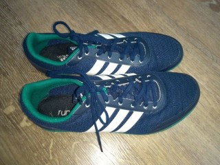 Running spikes in excellent condition (worn only a few times) Size 7.5 (UK)