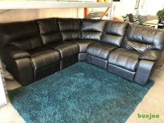 Black leather corner sofa , Ex display scs£599 includes delivery