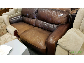 Tan leather two seater sofa